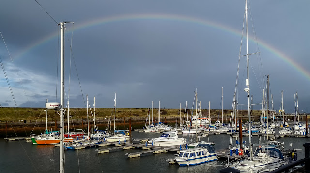 Photo of a rainbow over Maryport Marina