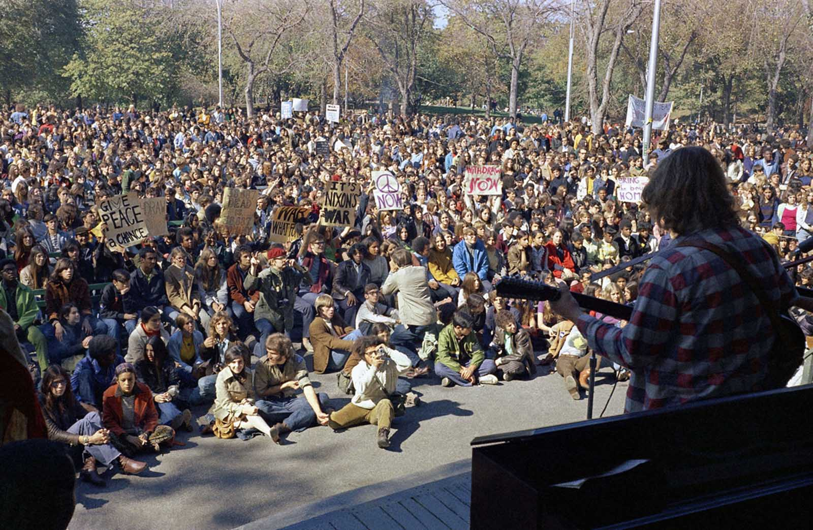 Demonstrators listen to a performer in Central Park on Moratorium Day, October 15, 1969. Moratorium Day was a mass demonstration and teach-in staged across the United States, in protest against continued American involvement in Vietnam.