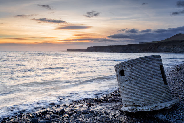 Sunset colours over Kimmeridge Bay and WW2 pillbox on the Dorset coast