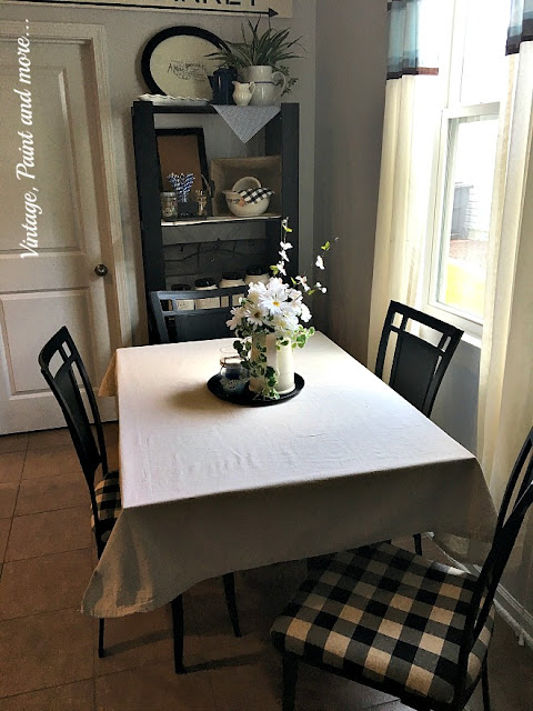 Vintage Paint and more... an awesome makeover done to a thrift store table and chairs with just some black chalkboard paint and some black and cream buffalo plaid fabric