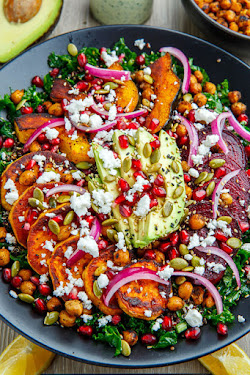 Roast Acorn Squash, Sweet Potato and Beet Kale and Quinoa Salad with Avocado, Feta and Pomegranate in a Cilantro Lemon Tahini Dressing