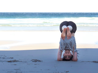 Sirsasana variation - Holding the legs horizontally is great work for the abdominals and hip flexors, as long as the shoulders are strong enough to avoid strain being placed on the neck. ...the safety of doing this on beach sand is questionable :)