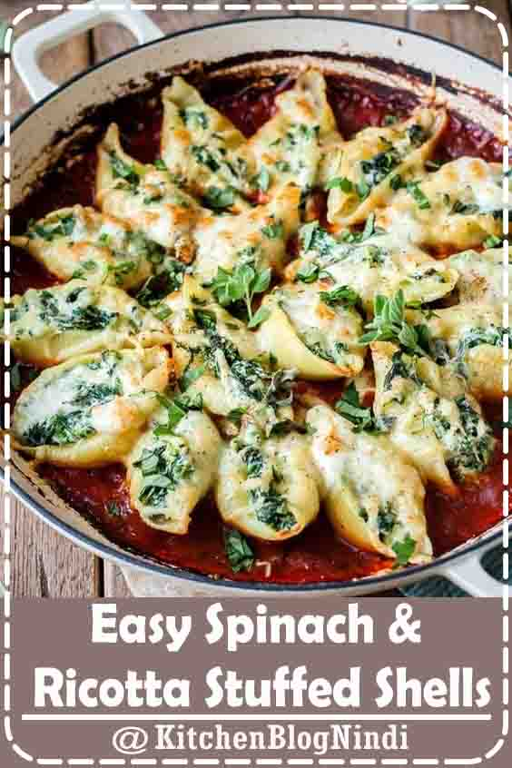 4.9★★★★★   Giant ricotta stuffed shells with creamy and delicious mozzarella and spinach make the most amazing and quick weeknight dinner. It's a completely vegetarian dinner that uses only a couple of pantry ingredients and is easy enough for weeknight dinners! #EasySpinach #Ricotta #StuffedShell
