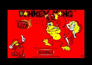 Pantalla de carga de Donkey Kong para Amstrad CPC con el texto, el gorila y Jumpman (Mario). Créditos de Ocean y Nintendo (1986)