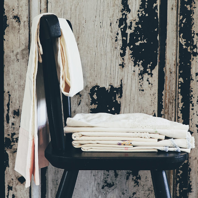 chair with vintage linens