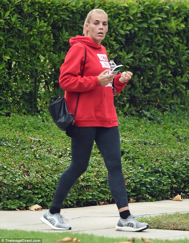 Busy Philipps steps out makeup free in leggings and a hoodie after workout at LA gym