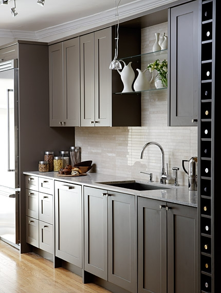 Dark painted cabinets in kitchen with open glass shelving by Sarah Richardson