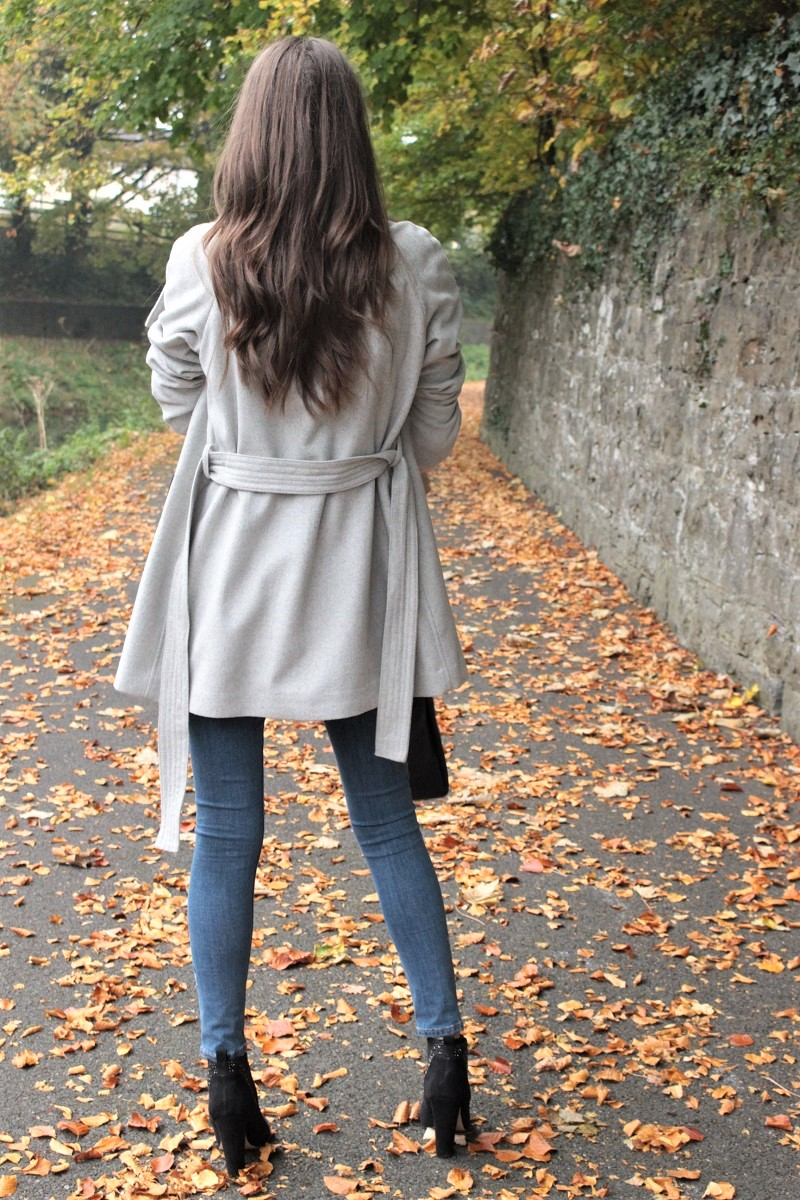 long hair, brunette, grey coat,