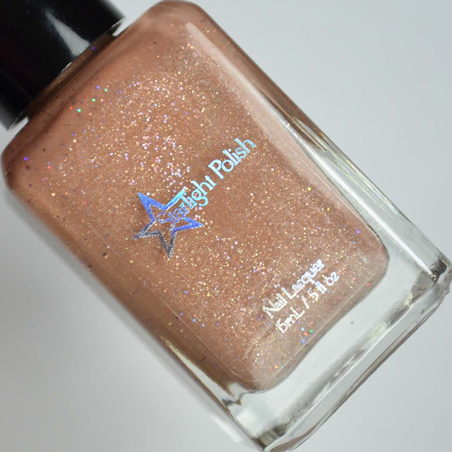 light brown holo nail polish in a bottle