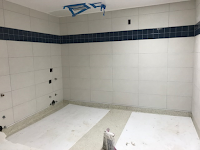 New Dark Blue and White Wall Tiling in the Women's Restroom