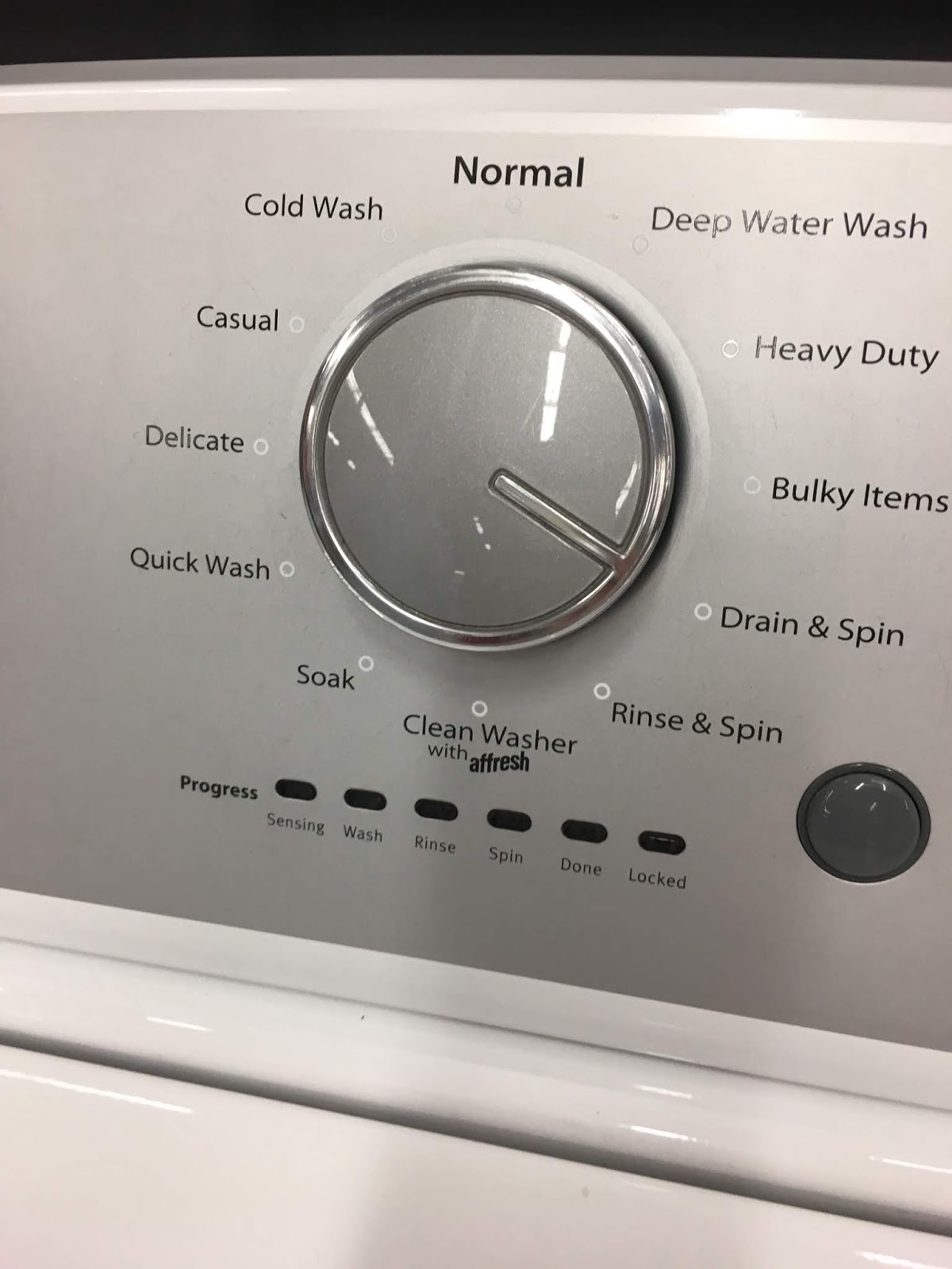 a close up of a basic dial on washing machine