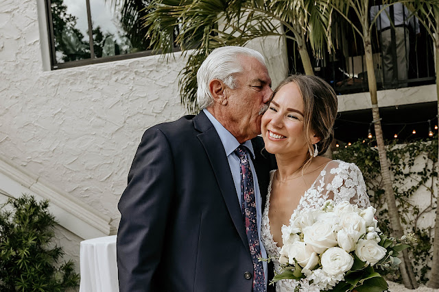 Father kissing Bride on the cheek before Ceremony The Manor on St Lucie Crescent Wedding captured by Stuart Wedding Photographer Heather Houghton Photography