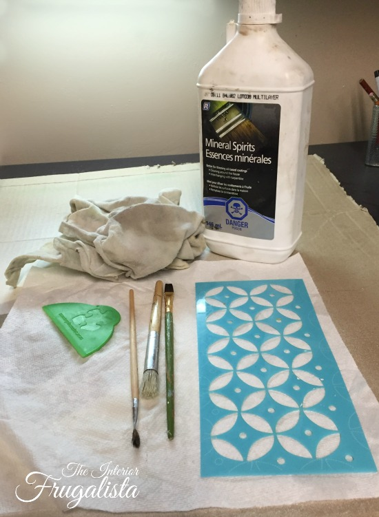 Mineral spirits removes wax from a stencil and stencil brush