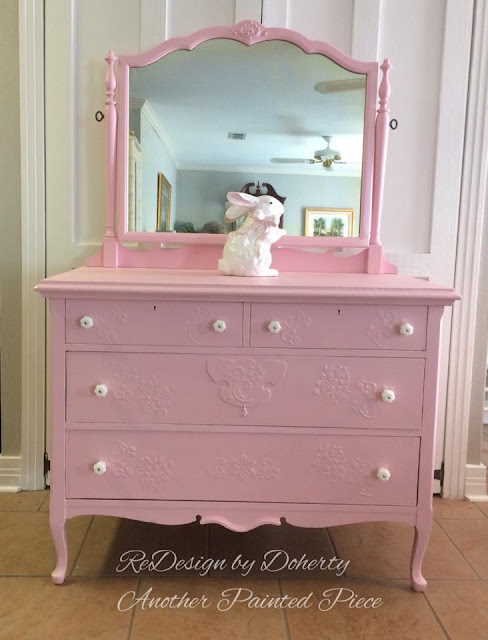 pink vanity with milk glass
