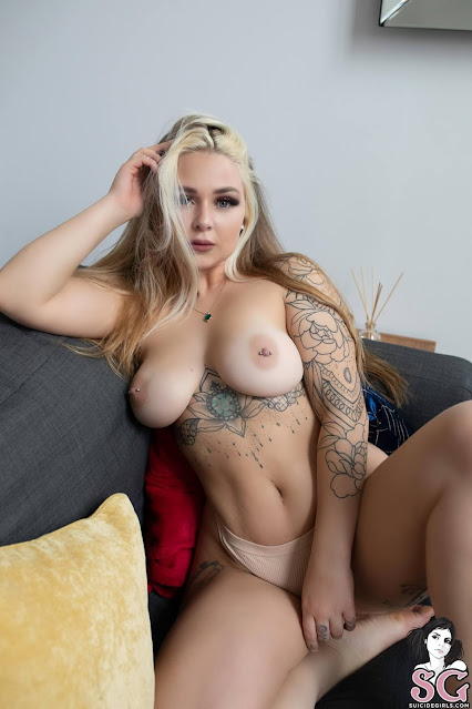 Nude shots of sexy busty tattoo woman 1