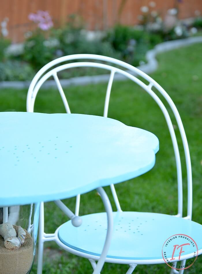 How to turn a hurricane candle holder with metal base and thrift store cafe chairs into a unique one-of-a-kind Coastal Bistro Dining Set for summer.