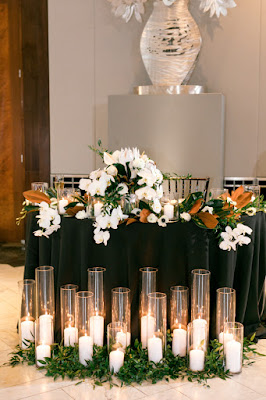 black sweetheart table with candles