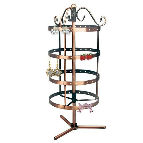 A rotating jewelry display stand in metal for dangling earrings.