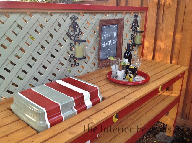 This simple DIY Gardener's Potting Bench can be built in an afternoon with 2x4s. A potting table by day and outdoor bar with solar lights at night.