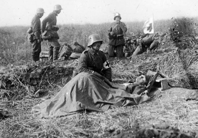 Walter was just 16 when he fought at the Somme but his photos soon took on dark tone. Here he captures a German army medic kneeling beside a dying colleague - but he can do no more than offer comfort.