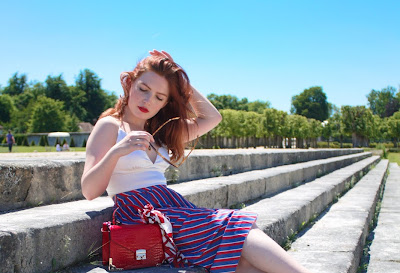 Feminine in white, red and blue