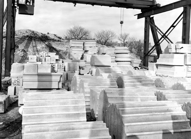 Easton, Bath and Portland Stone Firms, Ltd., Portland. Stack of finished masonry in Portland Stone. The diameter of sections of fluted columns in foreground is 4 ft. Works of Bath and Portland Stone Firms, Ltd.