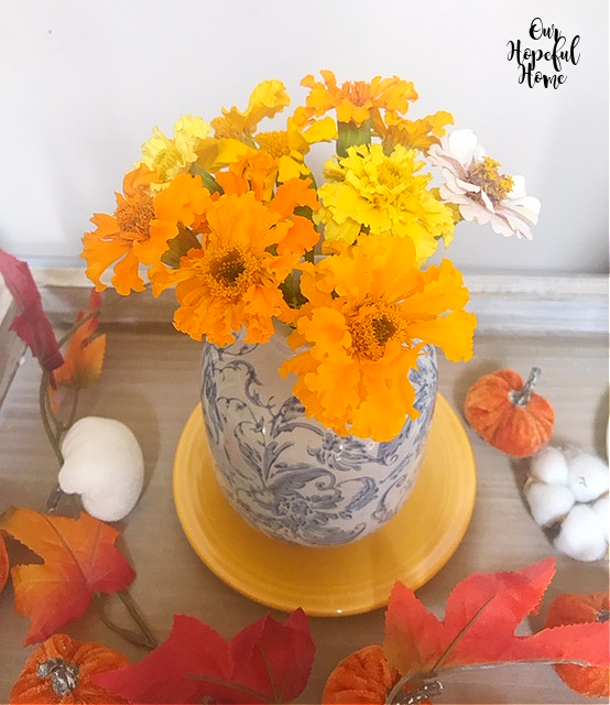 marigolds ble white vase leaf garland fall bouquet