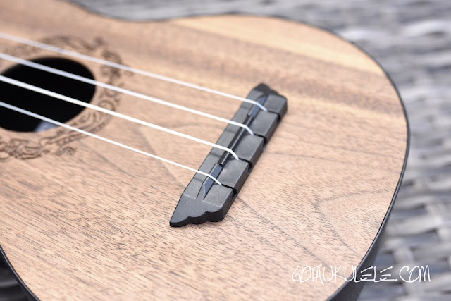 Flight Travel Ukulele bridge