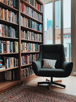 A bookshelf and reading chair