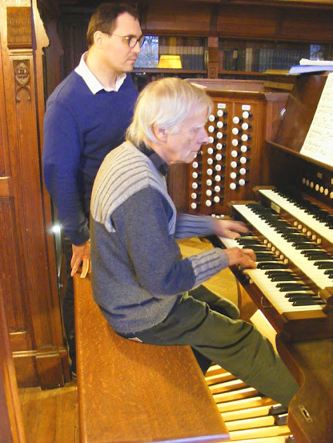 Playing the house organ at the Chateau de Cande.  Indre et Loire, France. Photographed by Susan Walter. Tour the Loire Valley with a classic car and a private guide.