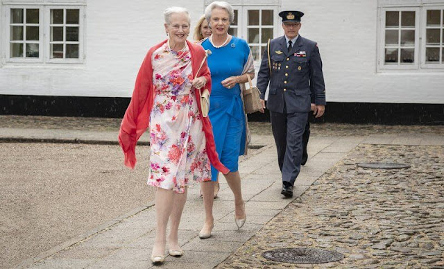Queen Margrethe wore a floral print silk summer midi dress. Princess Benedikte wore a blue silk midi dress
