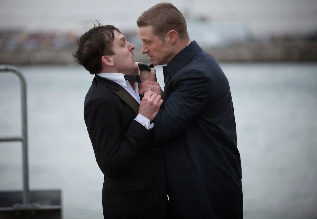 Ben McKenzie as Detective James Gordon with Robin Lord Taylor as Oswald Cobblepot The Penquin in Fox Gotham TV Show Pilot Episode