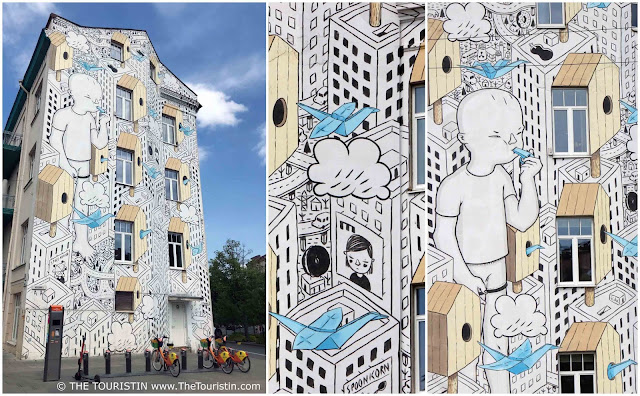 Facade with mural by Italian aritst Millo in Vilnius in Lithuania
