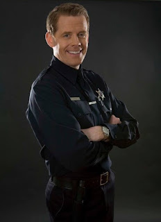 Picture of Doyle Devereux in a police dress