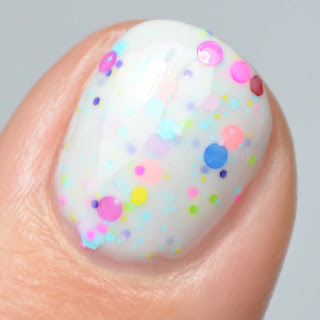 white crelly nail polish with neon glitter