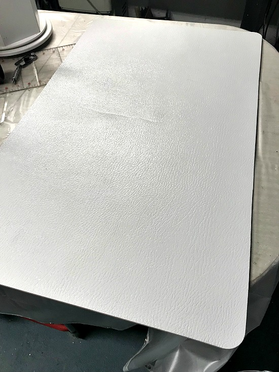 white painted and stenciled bathroom mat