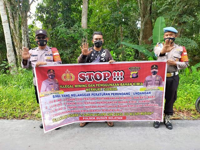 Melalui Spanduk, Personel Polsek Dusel Ajak Warga Stop Ilegal Mining dan Penggunaan Bahan Kimia