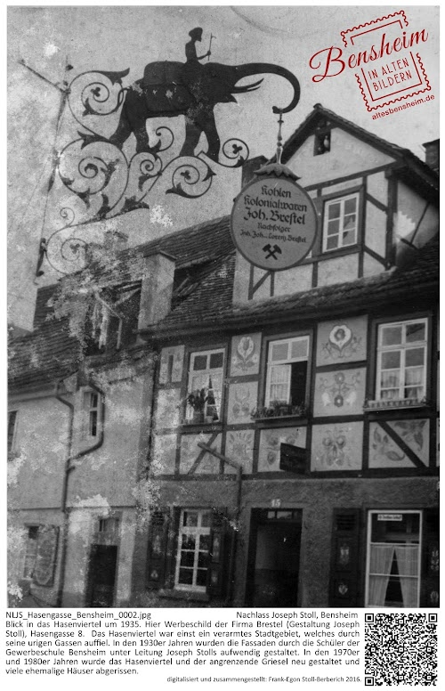 NLJS_Hasengasse_Bensheim_0002.jpg; Nachlass Joseph Stoll, Bensheim; Blick in das Hasenviertel um 1935. Hier Werbeschild der Firma Brestel (Gestaltung Joseph Stoll), Hasengasse 8.  Das Hasenviertel war einst ein verarmtes Stadtgebiet, welches durch seine urigen Gassen auffiel. In den 1930er Jahren wurden die Fassaden durch die Schüler der Gewerbeschule Bensheim unter Leitung Joseph Stolls aufwendig gestaltet. In den 1970er und 1980er Jahren wurde das Hasenviertel und der angrenzende Griesel neu gestaltet und viele ehemalige Häuser abgerissen.