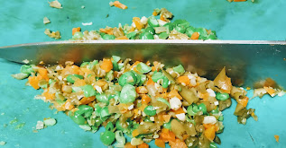 Chopping vegetables with knife for Hara bhara kabab Recipe