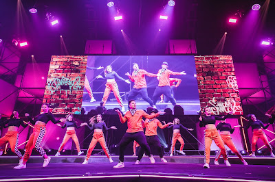 A photo of Jayden Rodrigues and his crew performing at YouTube Festival