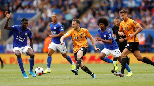 Leicester players try to mark Wolves Diogo Jota during a Premier League match