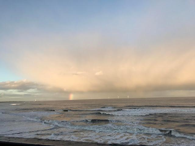 rainbow over the sea at whitley bay coast