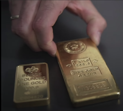 Picture showing a 10 ounces (about 283 grams) gold bar and a 1kg gold bar