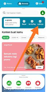 Selanjutnya pada halaman depan aplikasi Gojek, klik 'Lainnya'. Silahkan lihat petunjuk anak panah.