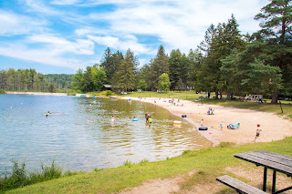 Visitors enjoy the beach at Lake Shaftsbury State Park.