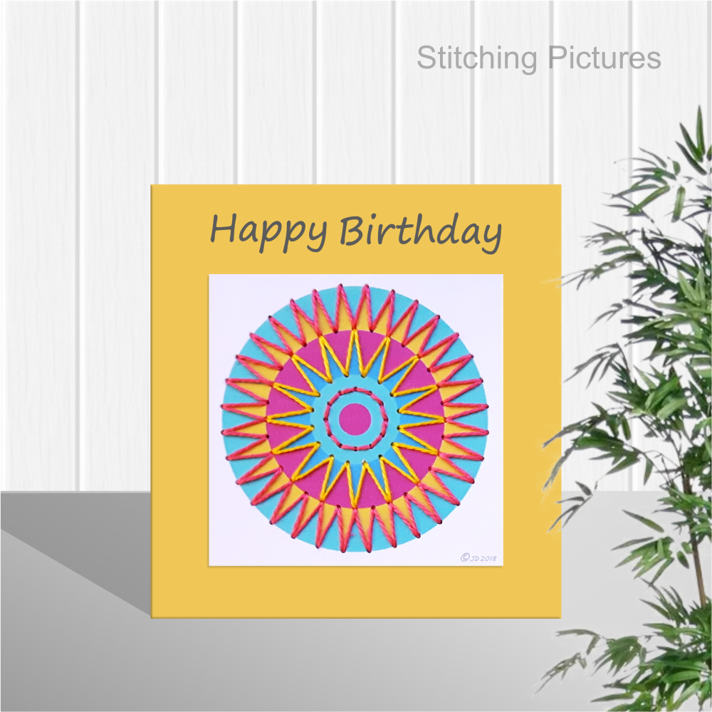Stitching pictures mini mandala paper embroidery pattern on a square greetings card.