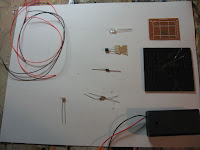 Electronic parts including solar cell, flickering LED, resistors and perf board