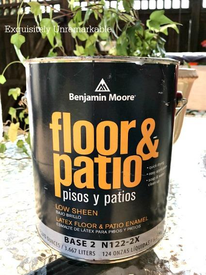 Benjamin Moore Floor and Patio Enamel Paint can on a table outside