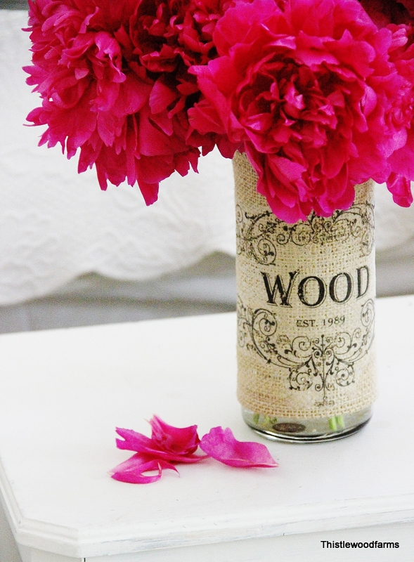 This flower vase wrapped in with a vintage graphic burlap is a fancy centerpiece
