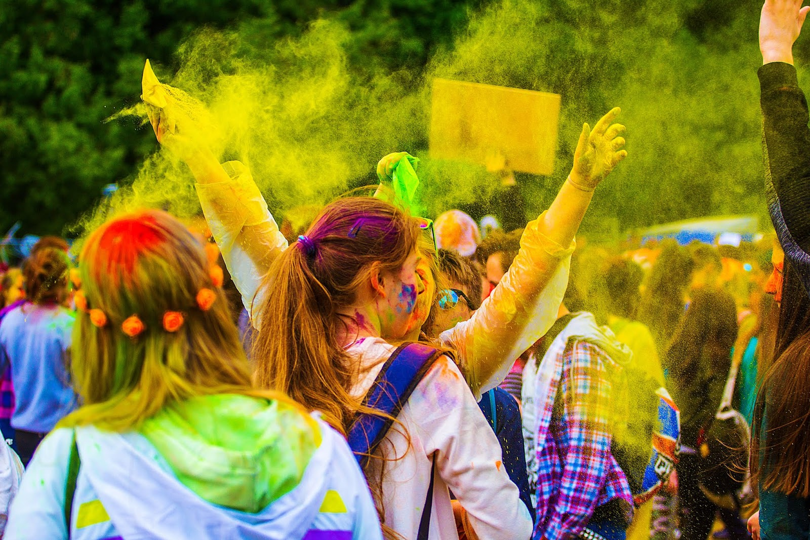 Why Holi is Celebrated in India in 2020 - many girls with holi festival colors